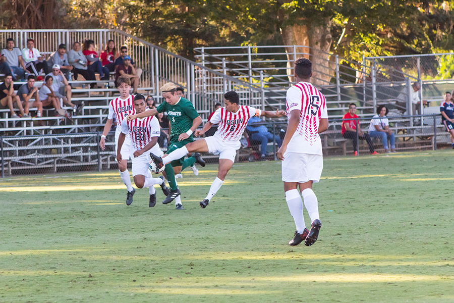 Sacramento State junior defender Jack Larter fights through three California State University, Northridge defenders to advance the ball Sept. 28 at Hornet Field.