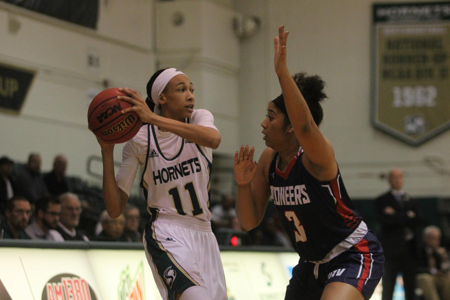 Sacramento State freshman guard 	Dana DeGraffenreid looks to pass the ball against Antelope Valley junior guard 	Samantha Earl Wednesday, Dec. 6 at the Nest. The Hornets defeated the Pioneers 95-62 in their home opener.