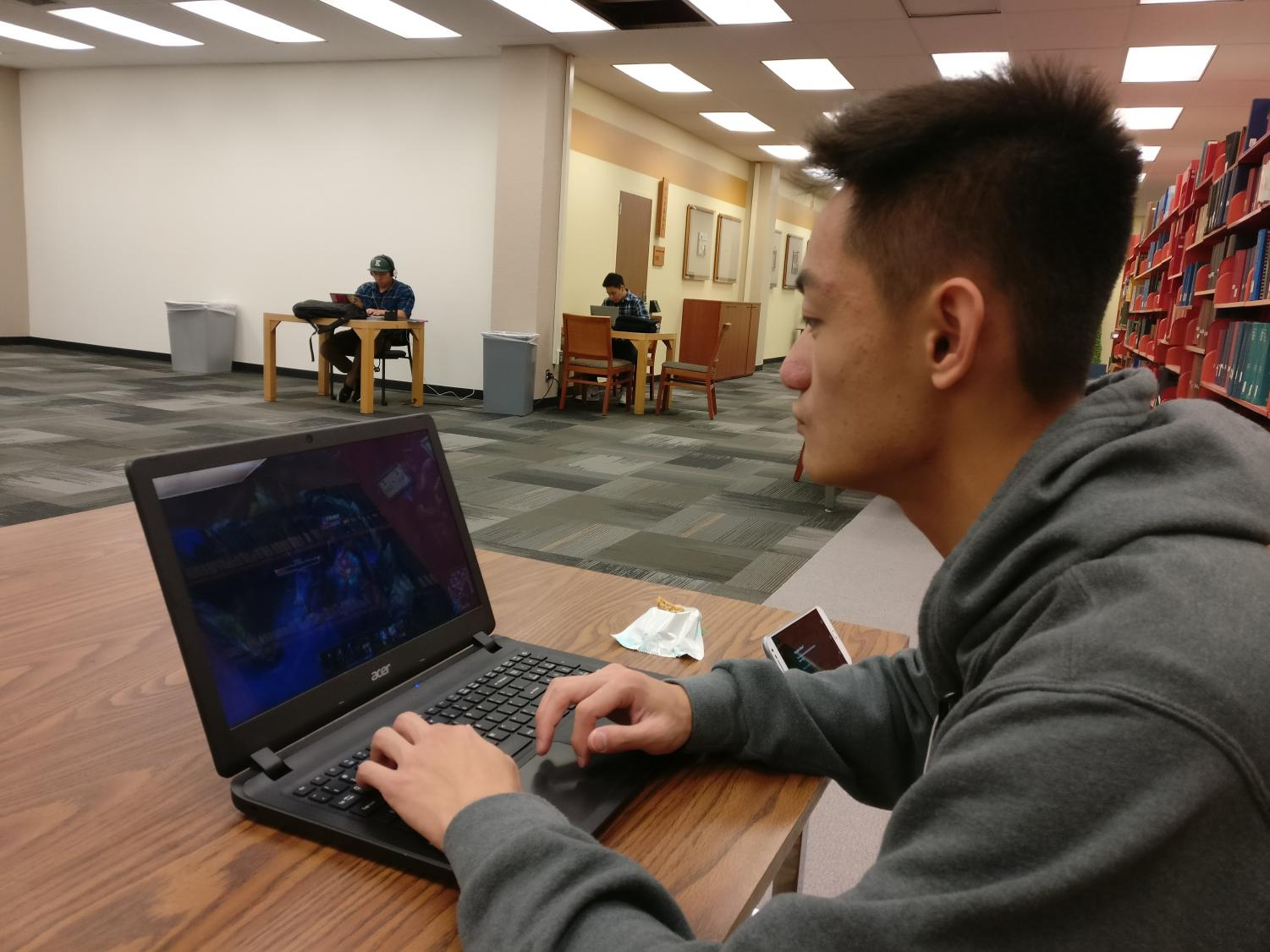 "Sacramento State freshman finance major Anthony Thao plays ""League of Legends"" in the University Library on campus."