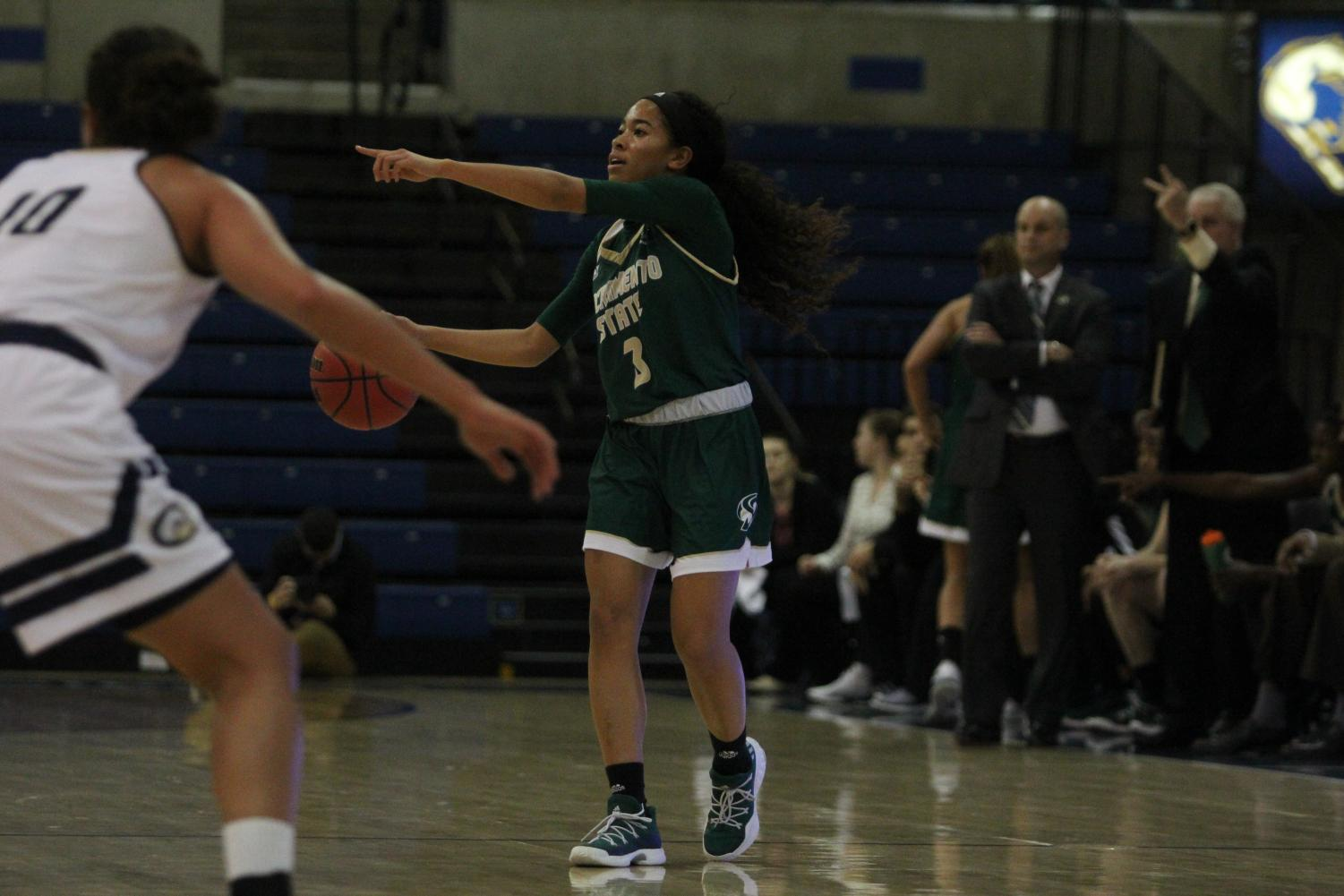 Sacramento State sophomore guard Tiara Scott directs her teammates in a 79-72 loss against UC Davis Thursday, Nov. 30 at The Pavilion in Davis.