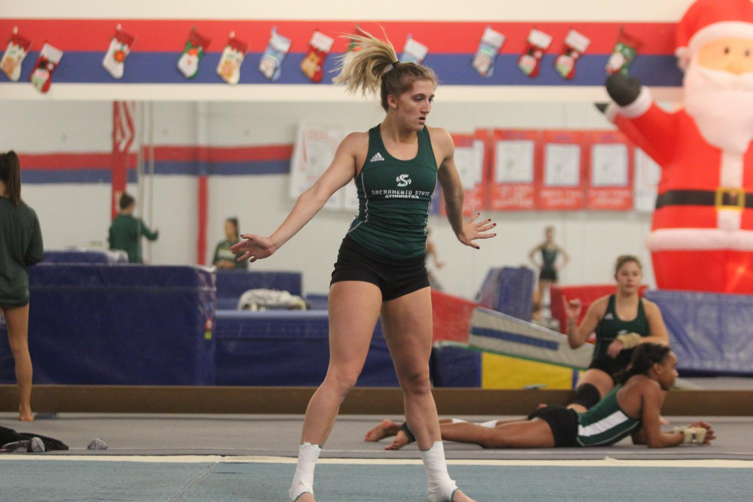 Sacramento State senior gymnast Caitlin Soliwoda works on her floor routine Nov. 27 at Byers Gymnastics Center in Elk Grove. Soliwoda will be one of the 18 returners from last year's 24 routines for the Hornets.