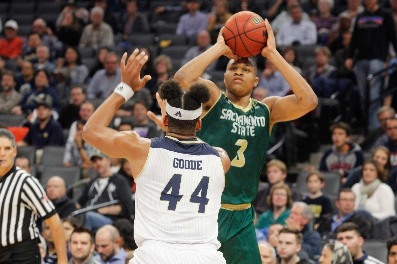 Sacramento State senior forward Justin Strings shoots the ball over UC Davis junior forward Garrison Goode Tuesday, Nov. 21 at the Golden 1 Center. Strings posted 17 points, 12 rebounds and 10 turnovers in a 64-47 loss against the Aggies.