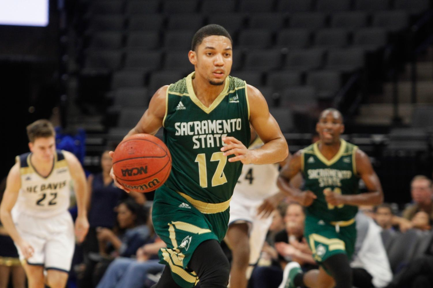 Sacramento State junior guard Jordan Tolbert dribbles the ball down the court in a 64-47 loss against UC Davis at the Golden 1 Center on Tuesday, Nov. 21, 2017.