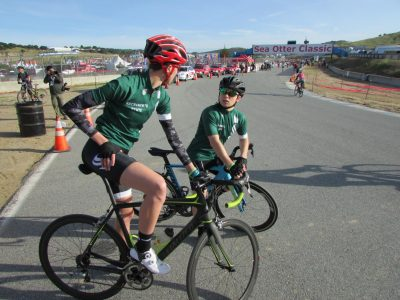 Sacramento State Cycling Club President Makenzie DeLaughder, left, takes a break next to team safety officer Joseph Rempe, right, during the Sea Otter Classic in Santa Cruz, California.