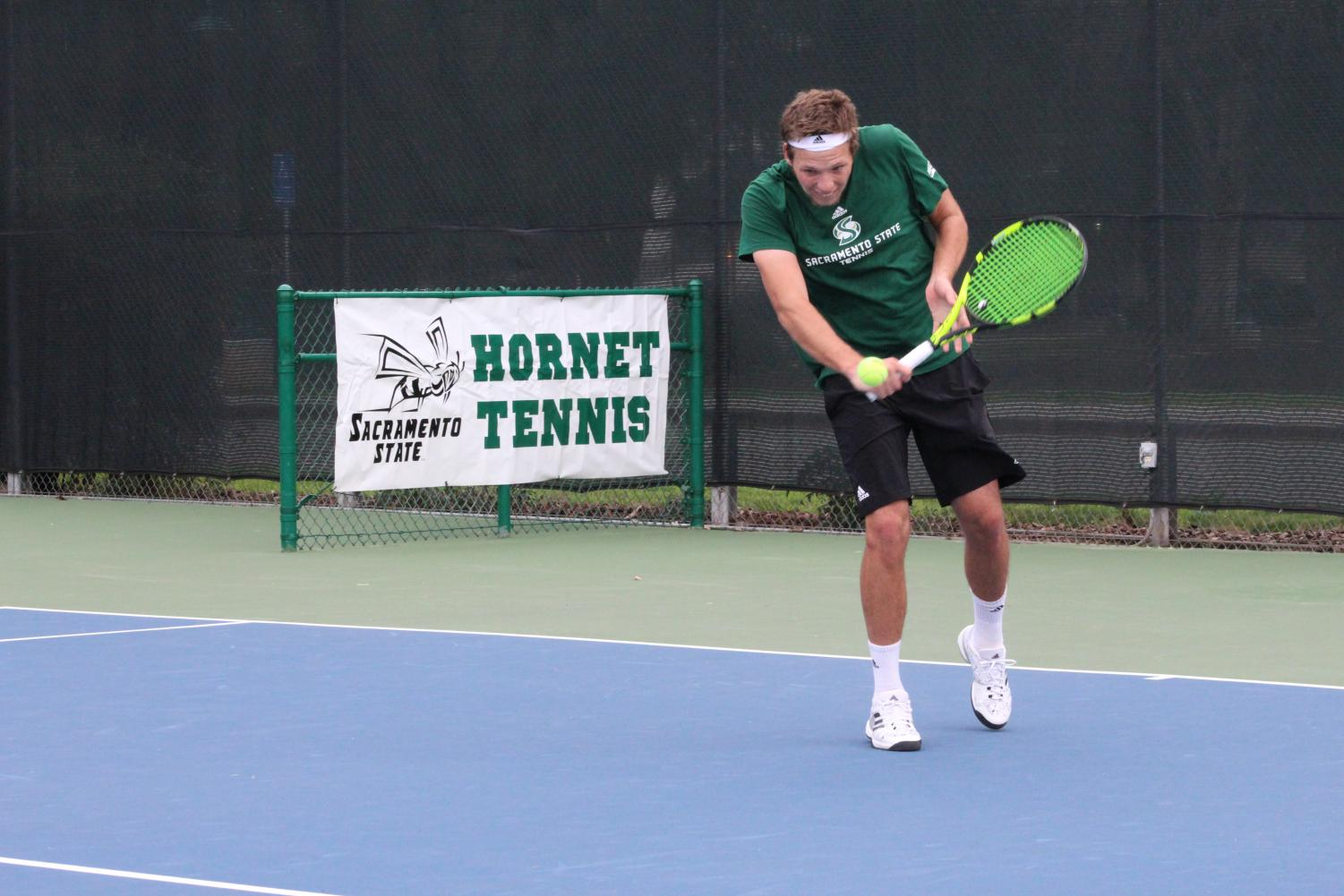 Sacramento State junior Mikus Losbergs backhands the ball during a singles match against Cal Poly Sunday, Jan. 21 at the Sacramento State Courts.