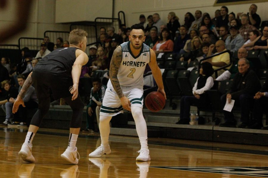 Sacramento State sophomore guard Izayah Mauriohooho-Le'afa dribbles the ball in the first half of the Hornets' 78-66 loss to Montana at the Nest on Thursday, Jan. 11, 2018.