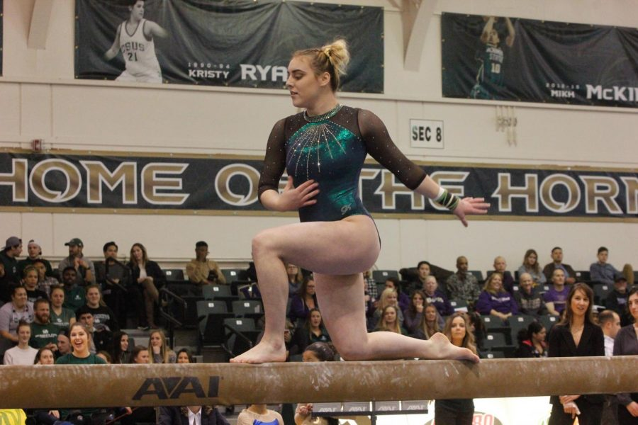 Sacramento State gymnast Lauren Rice performs her balance beam routine in a 195.350-191.500 loss to the University of Washington Friday, Jan. 12 at the Nest. Rice was helped off the floor after suffering an ankle injury during her floor routine.