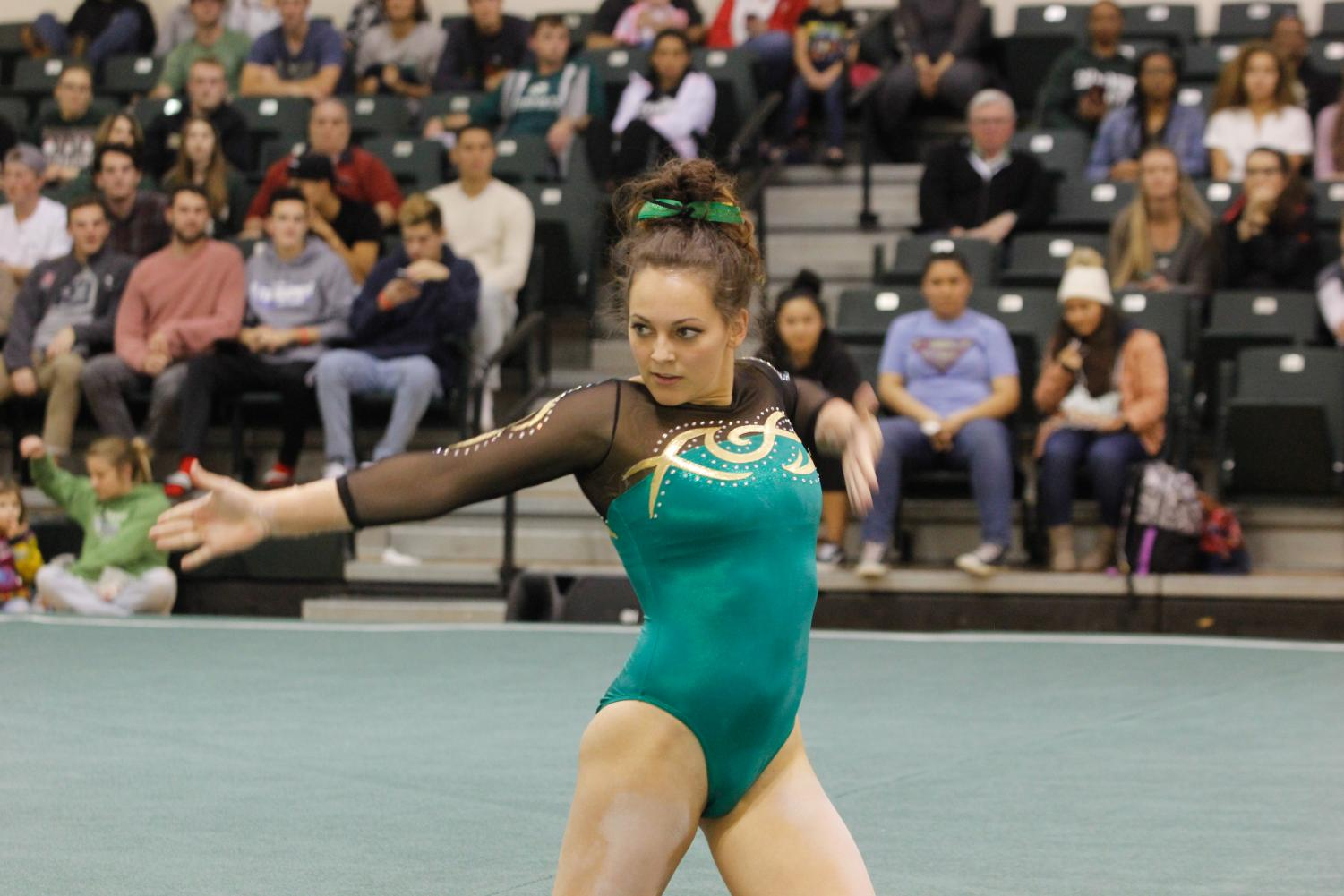 Sacramento State senior gymnast Annie Juarez competes on the floor event on Dec. 8 at Flip Fest.
