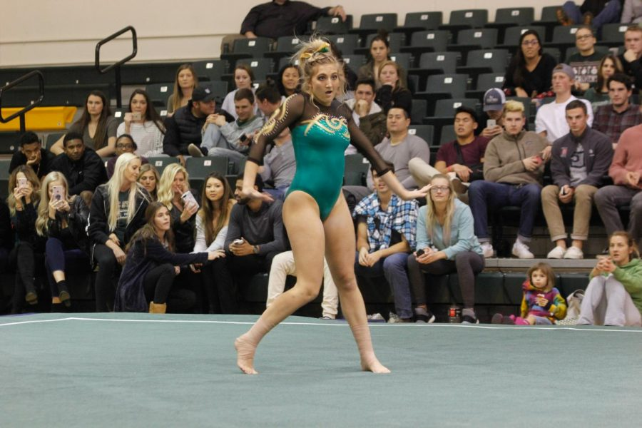 Sacramento State senior gymnast Caitlin Soliwoda performs her floor routine at Flip Fest Dec. 8 at the Nest. Soliwoda performed on bars and beam at the NorCal Classic before exiting with an apparent ankle injury.