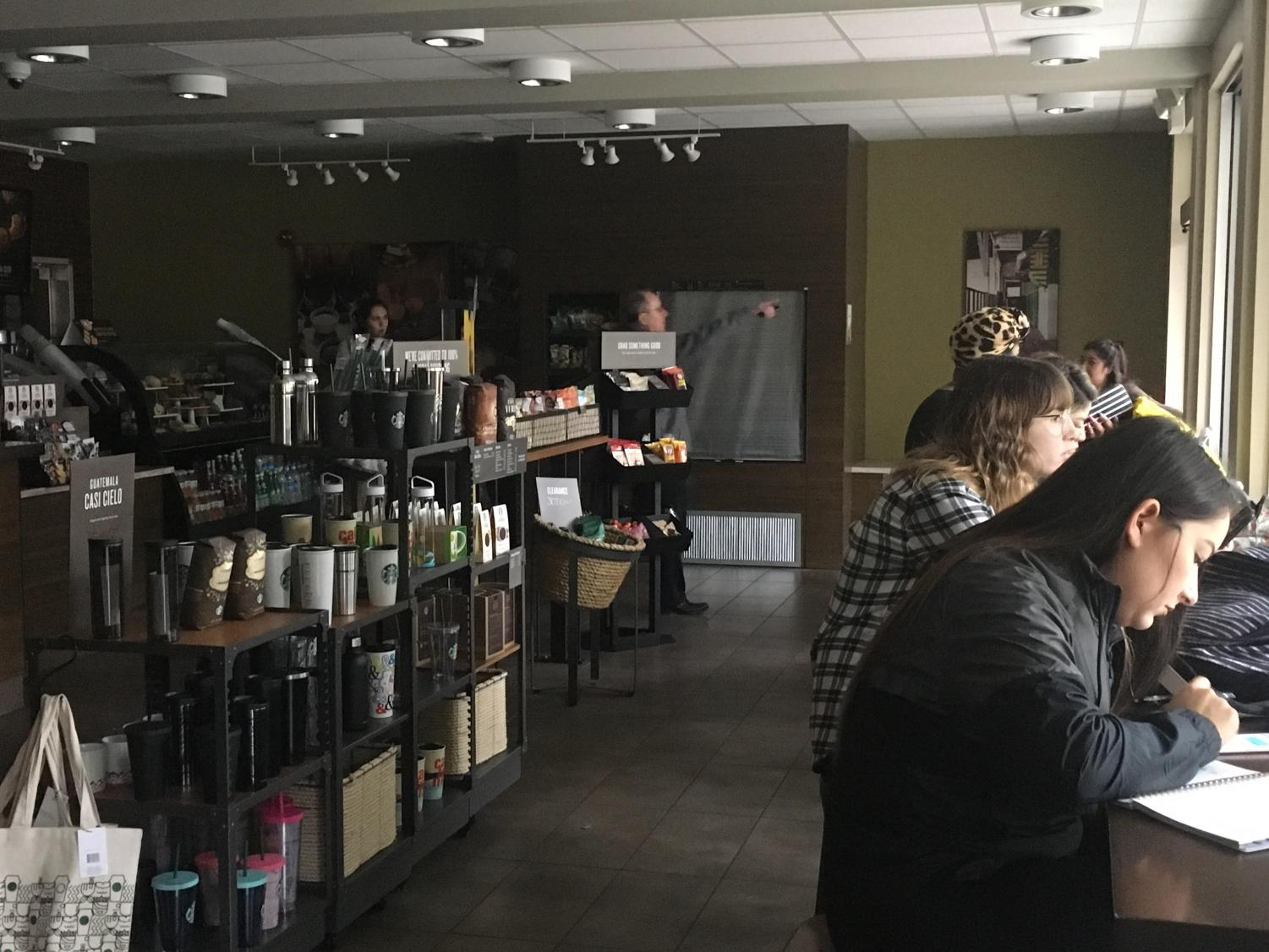 Students sit in Starbucks without light after an unscheduled campus-wide power outage took place Jan. 22. Restaurants inside River Front Center were temporarily closed and classes were cancelled in Del Norte Hall.
