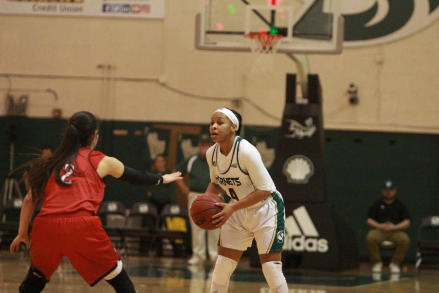 Sacramento State senior guard Justyce Dawson scans the floor while being guarded by Southern Utah sophomore guard Rebecca Cardenas in the first half of a 79-77 win at the Nest on Saturday, Feb 24, 2018. Dawson scored nine points including the game-winning layup.
