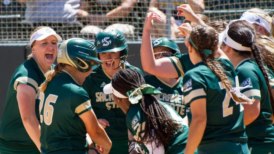 The Sacramento State softball team celebrates a home run by sophomore third baseman Mo Spieth against Northern Colorado April 29 at Shea Stadium. The Hornets will open their season in the Capital City Kickoff from Feb. 9-11 at Sac State.