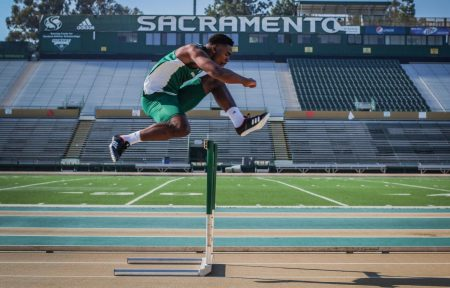 Sacramento State junior Andre Lindsey warms up with some hurdles before track practice on Feb. 5 at Hornet Stadium. Lindsey competes in football as a receiver and indoor and outdoor track as a hurdler.