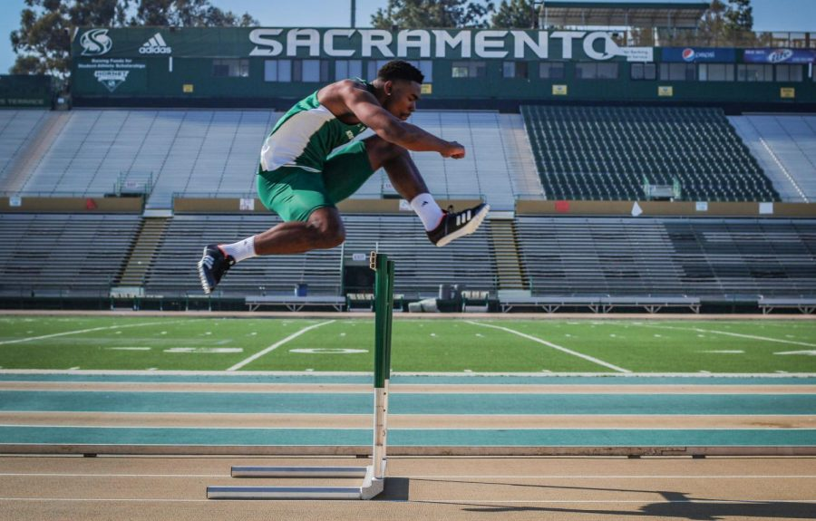Sacramento+State+junior+Andre+Lindsey+warms+up+with+some+hurdles+before+track+practice+on+Feb.+5+at+Hornet+Stadium.+Lindsey+competes+in+football+as+a+receiver+and+indoor+and+outdoor+track+as+a+hurdler.