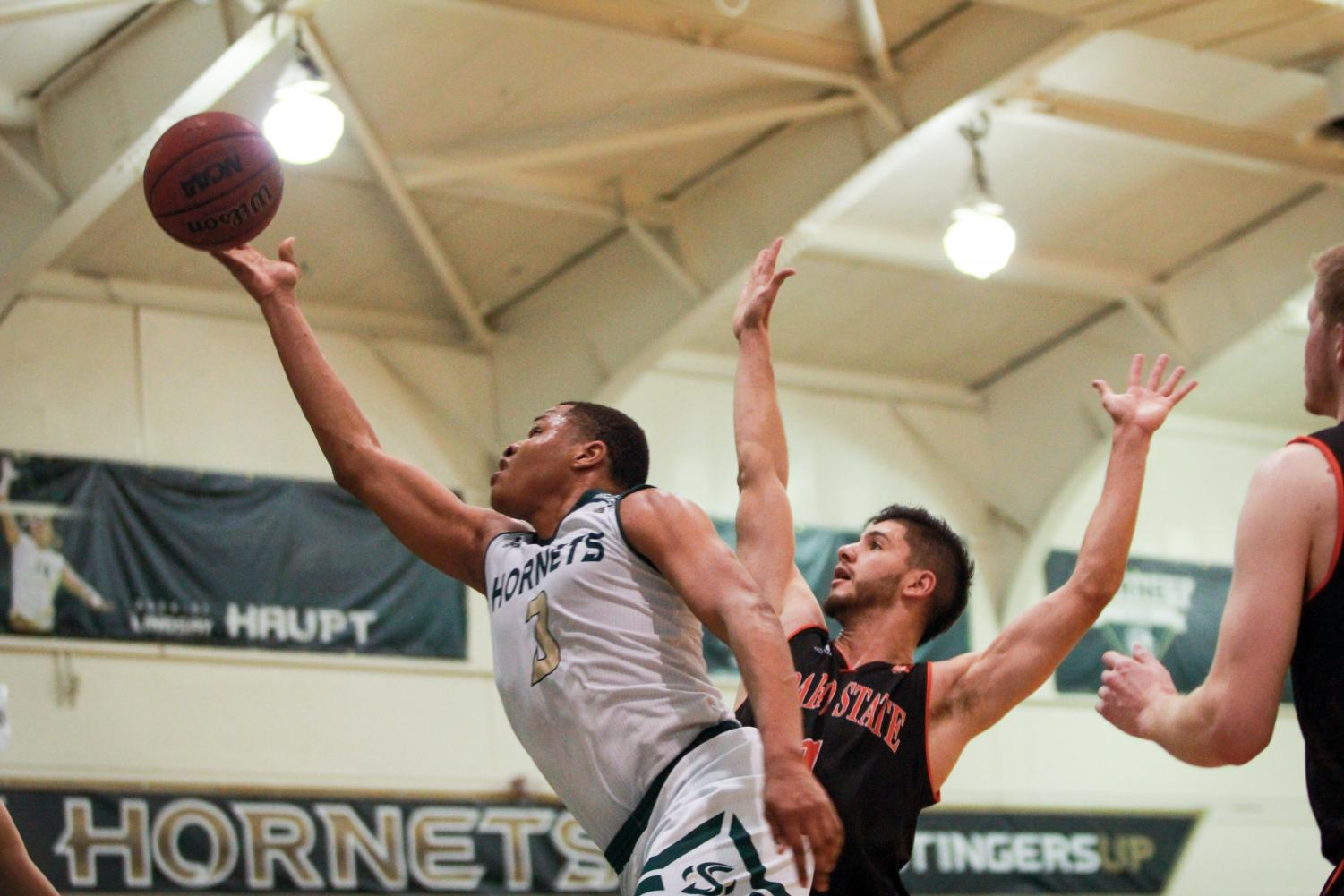 Sacramento State senior forward Justin Strings shoots a layup against Idaho State Thursday, Feb. 15 at the Nest. Strings finished with 24 points in a 67-64 loss to the Bengals.