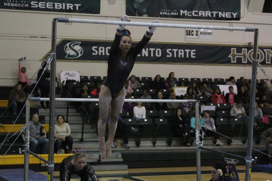 Sacramento+State+senior+gymnast+Annie+Juarez+performs+her+uneven+bars+routine+Friday%2C+Feb.+16+at+the+Nest.+Juarez+recorded+a+9.800+on+the+routine+and+scored+a+career-high+39.200+as+an+all-arounder.