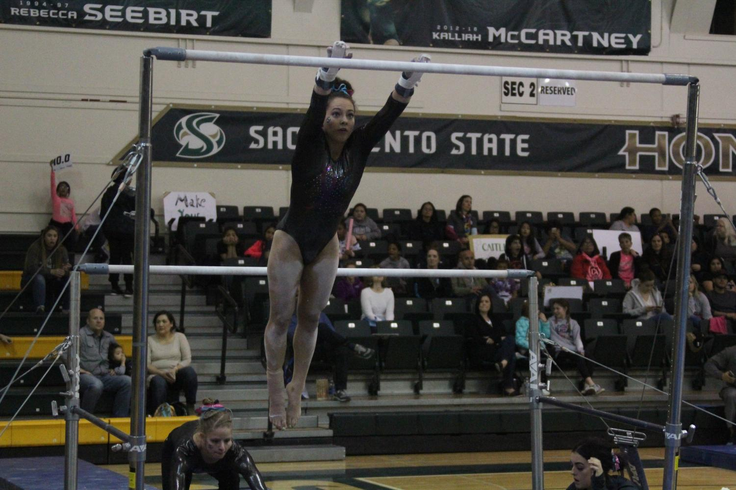 Sacramento State senior gymnast Annie Juarez performs her uneven bars routine Friday, Feb. 16 at the Nest. Juarez recorded a 9.800 on the routine and scored a career-high 39.200 as an all-arounder.