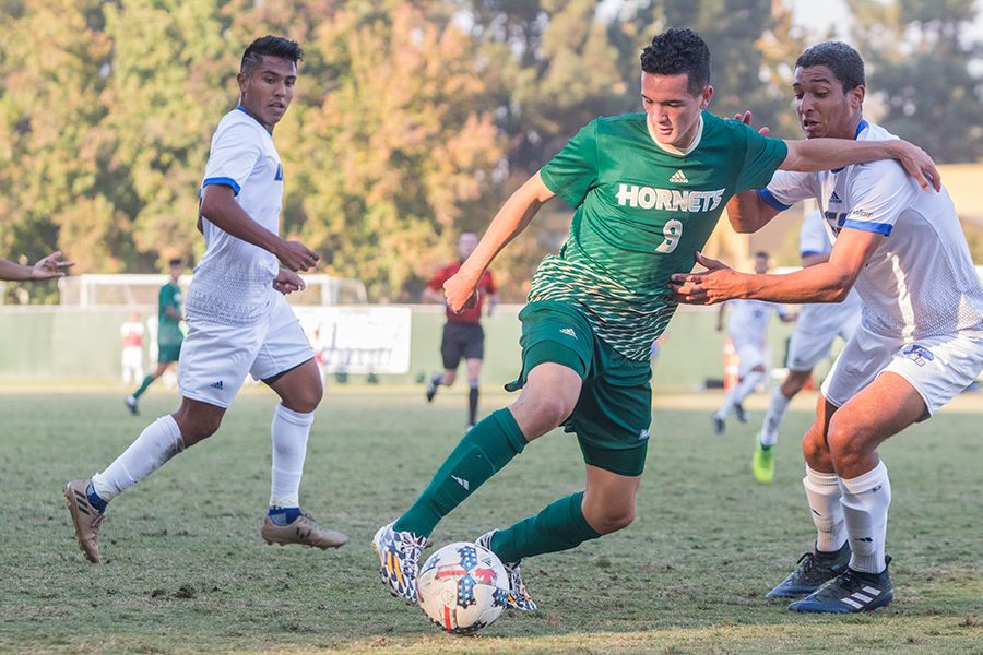 Sacramento State sophomore midfielder Christian Webb fights off UC Santa Barbara freshman defender Adrian Adames on Oct. 18 at Hornet Field. The men's and women's soccer programs will begin their spring preseason on March 3 and March 10, respectively, at Sac State.