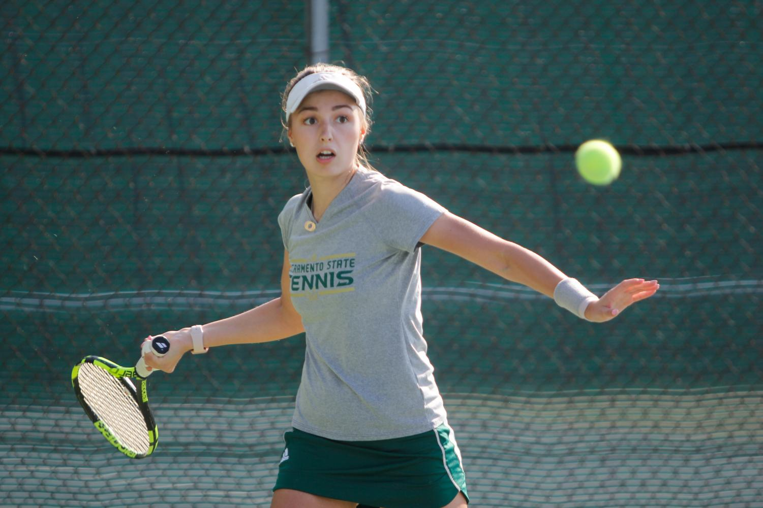 Sacramento State sophomore Sofia Gulnova prepares to hit the ball back in her doubles match with junior Sofi Wicker against their Nevada opponents Saturday, Feb. 3 at the Sacramento State Courts.