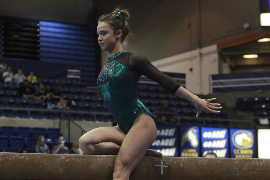 Sacramento State junior Lauren Schmeiss competes on the balance beam at UC Davis on Friday, Feb. 9, 2018. Schmeiss recorded a 9.700 and has also finished with scores of 9.700 or higher in five of her seven events this season.