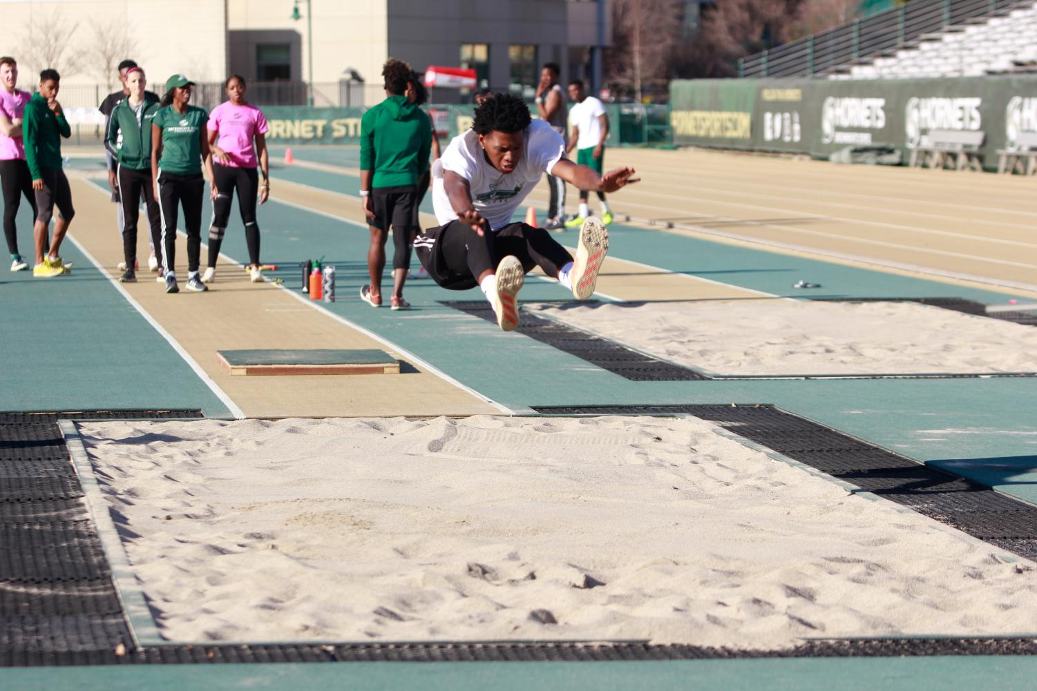 Sacramento State sophomore Jah Strange performs a triple jump during track practice on Feb. 14 at Hornet Stadium. Strange set a Sac State record for the men's indoor triple jump with a leap of 51 feet and three inches (51-03.50) on Feb. 3.