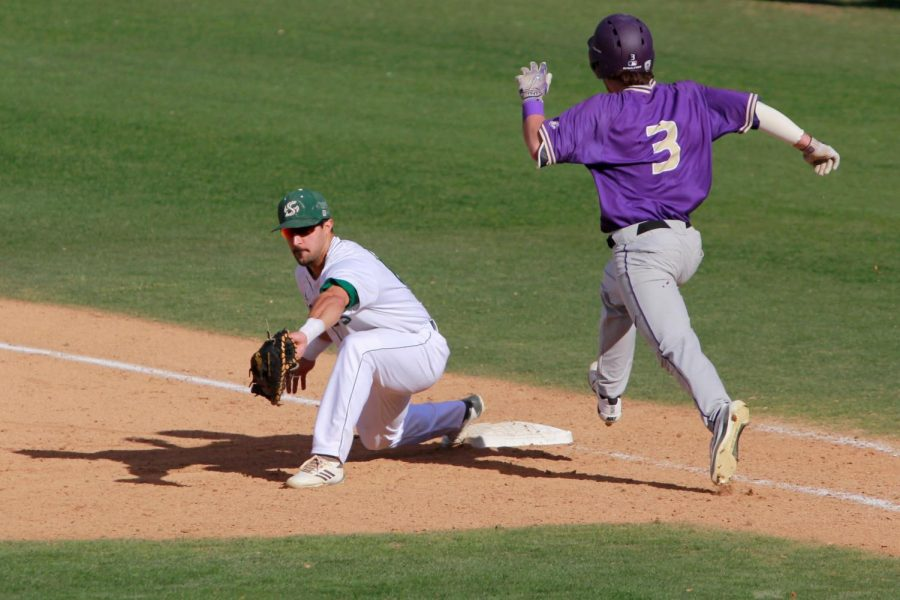 Sacramento+State+senior+first+baseman+Vinny+Esposito+catches+a+ball+at+first+base+to+record+an+out+on+freshman+Jonathan+Schiffer+Sunday%2C+Feb.+18+at+John+Smith+Field.+The+Hornets+defeated+the+Washington+Huskies+6-0.