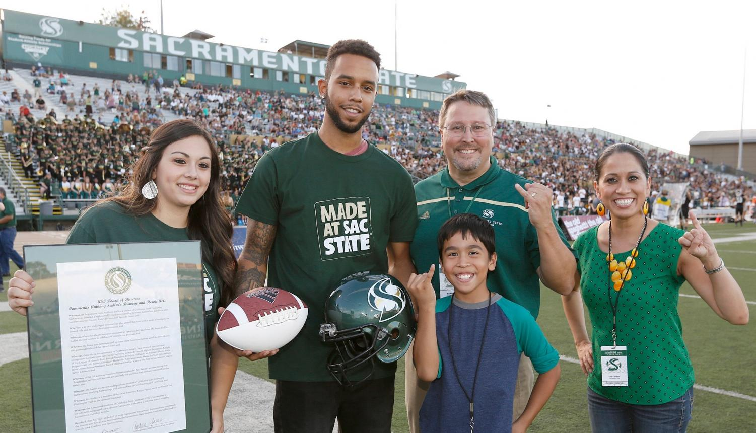 Anthony Sadler poses at Hornet Stadium on Sept. 26, 2015. After Sadler and two friends helped stop a terrorist on a train from Amsterdam to Paris, the three men play themselves in a film directed by Clint Eastwood.