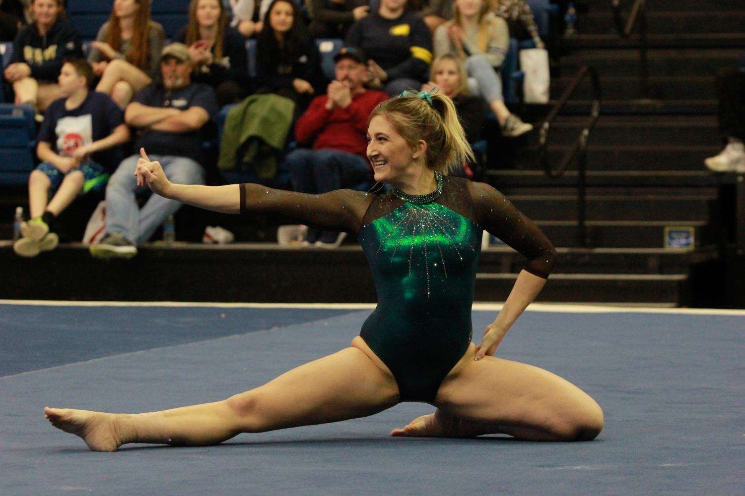 Sacramento State senior gymnast Caitlin Soliwoda finishes her floor routine Friday, Feb. 9 at UC Davis. Soliwoda recorded a 9.725 in the event and a 39.125 as an all-arounder.