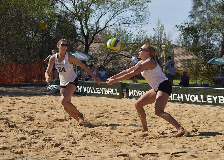 Sacramento State then-junior Kennedy Kurtz bump sets the ball for then-freshman Sarah Davis in a match against San Jose State at Livermore Community Park in Folsom on Saturday, March 11, 2017. Sac State will begin its sixth season of beach volleyball on Friday at the Stanford Tournament in Palo Alto.