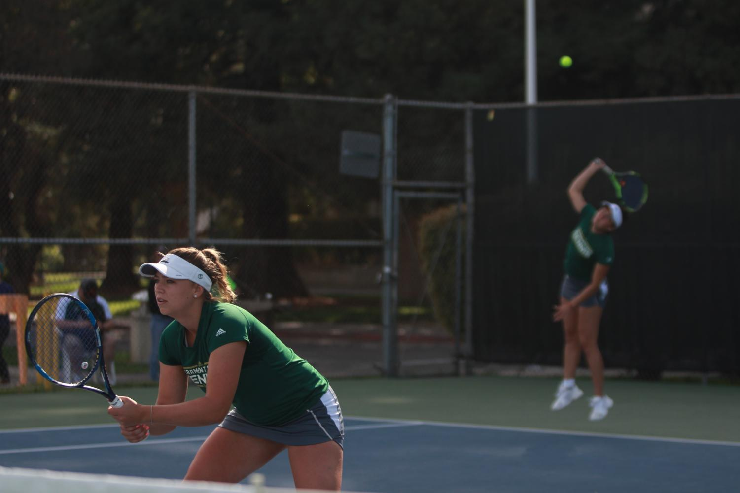 Sacramento State sophomore Carolina Chernyetsky gets ready for her doubles match while freshman Maria Gonzalez serves the ball to UC Irvine at the Sacramento State Courts on Friday, March 30, 2018.