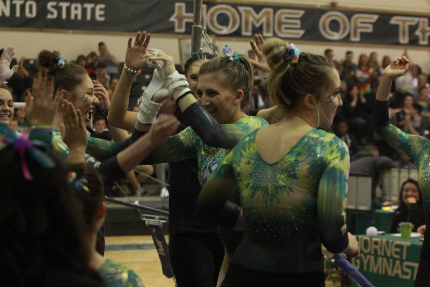 Sacramento State senior gymnast Caitlin Soliwoda celebrates after competing on the uneven bars at the Nest on Friday, March 9, 2018. Soliwoda was one of four Hornets to qualify for an NCAA Regional.