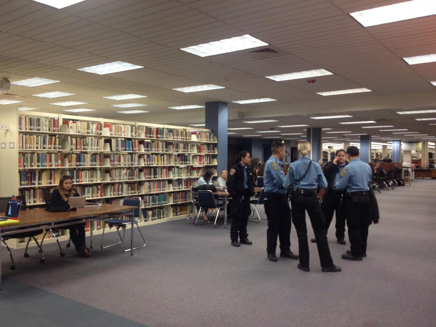 Community service officers from the Sacramento State Police Department gather while officers investigate a fight that broke out in the University Library on Tuesday, March 6, 2018. According to witnesses, the fight started after one person told someone else to leave for sneezing.
