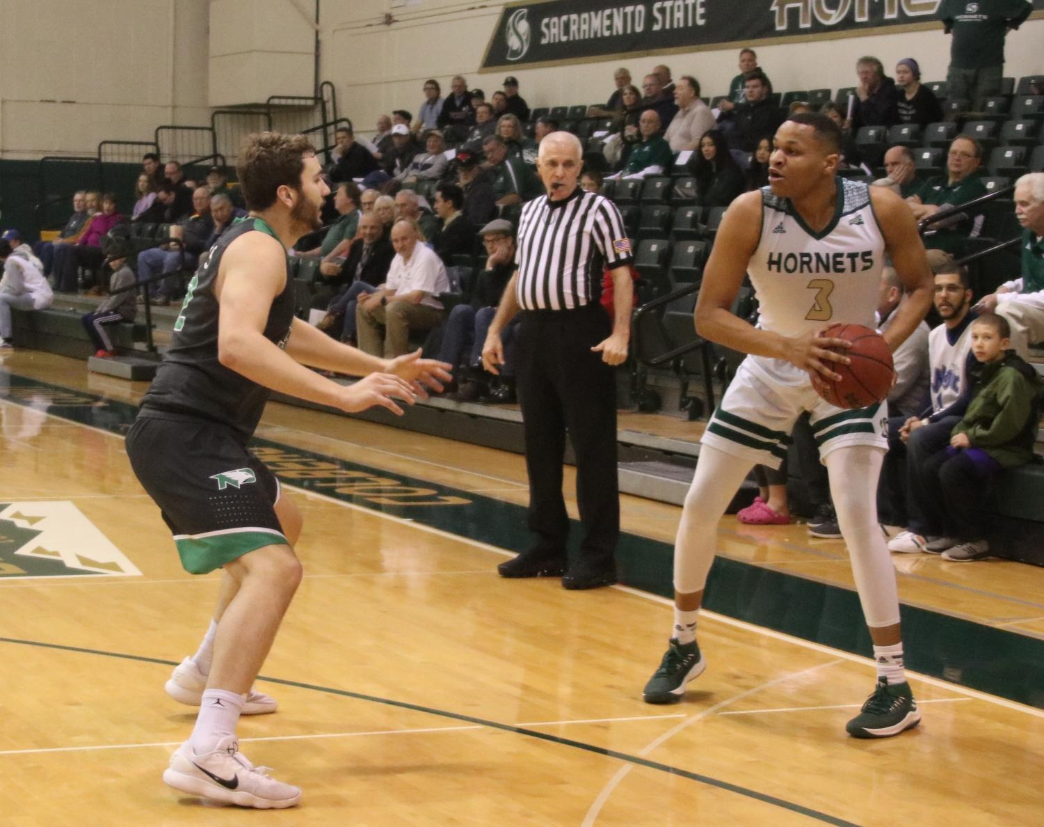 Sacramento State senior forward Justin Strings looks to pass the ball against North Dakota at the Nest on Thursday, March 1, 2018. Strings finished with 21 points in a 90-73 loss to North Dakota.