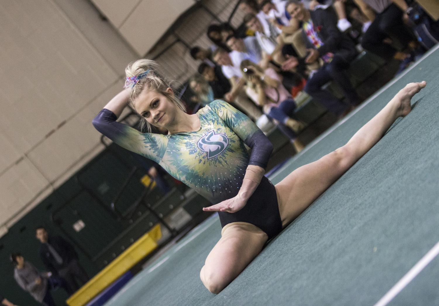 Sacramento State junior gymnast Jackie Sampson performs her floor routine at the Nest on Fri., March 9, 2018. Sampson set a career high of 9.825 in the event and the Hornets scored a 195.175 as a team.