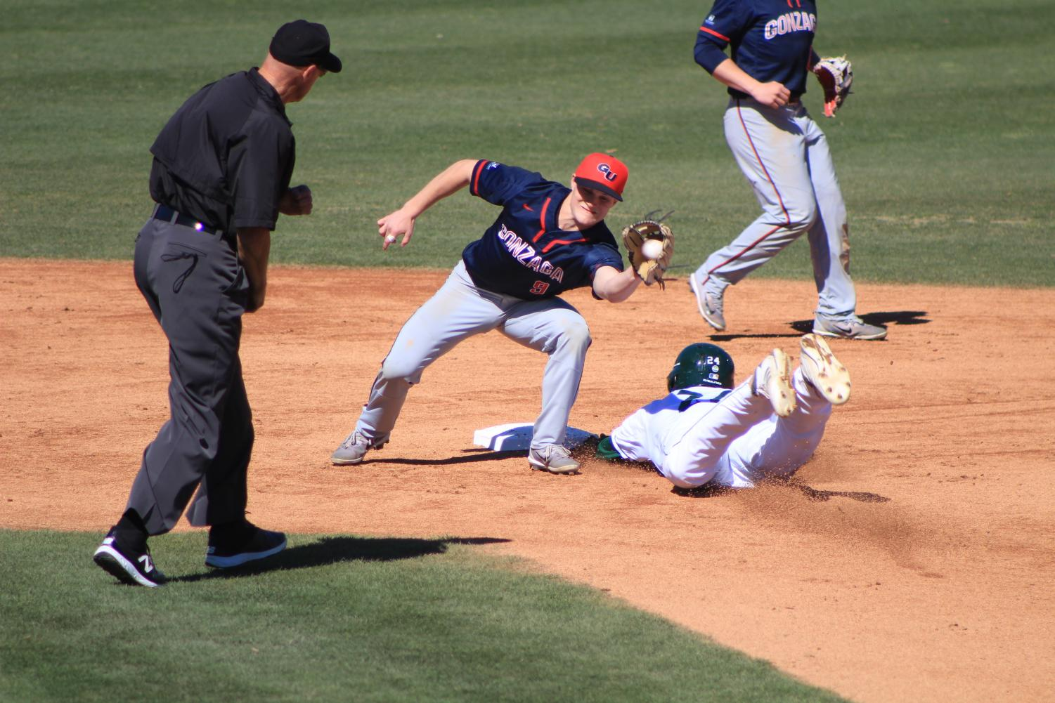 Sacramento State junior outfielder Matt Smith slides into second base safely against Gonzaga University at John Smith Field on Monday, March 5. The Hornets lost to the Bulldogs 6-3.