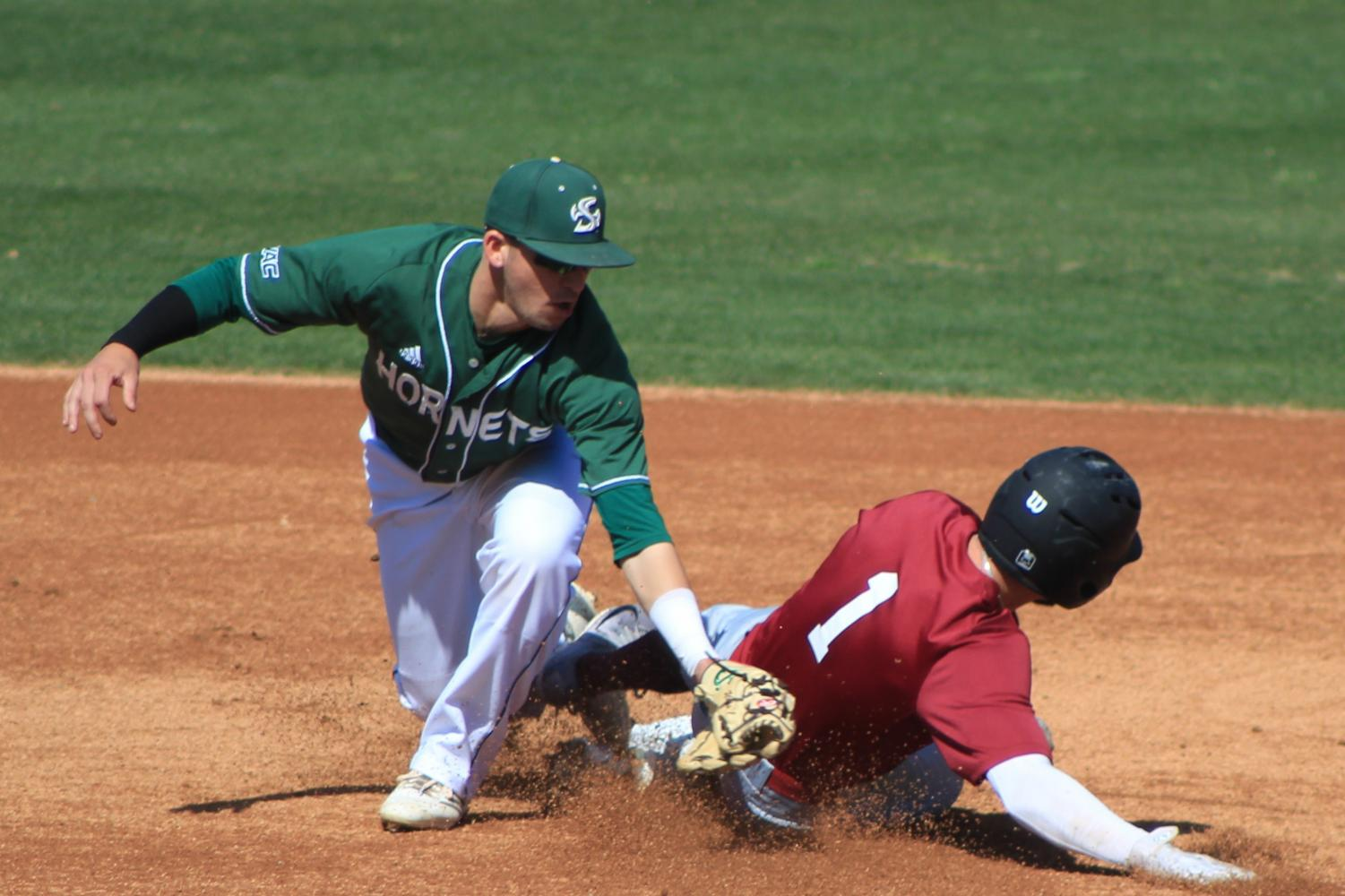 Sacramento State sophomore shortstop Josh Urps tags out Santa Clara University senior infielder Joe Becht during a steal attempt at second base at John Smith Field on Sunday, March 11, 2018. The Hornets defeated Santa Clara 4-1.