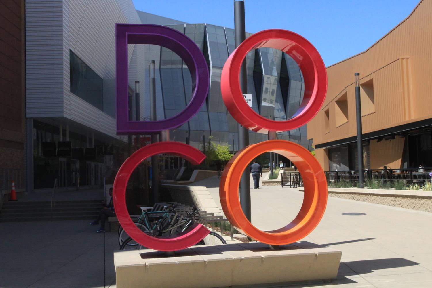 A sign promoting Downtown Commons is displayed outside Golden 1 Center. Since the arena opened in 2016, DOCO has become one of the hottest new developments in Sacramento.