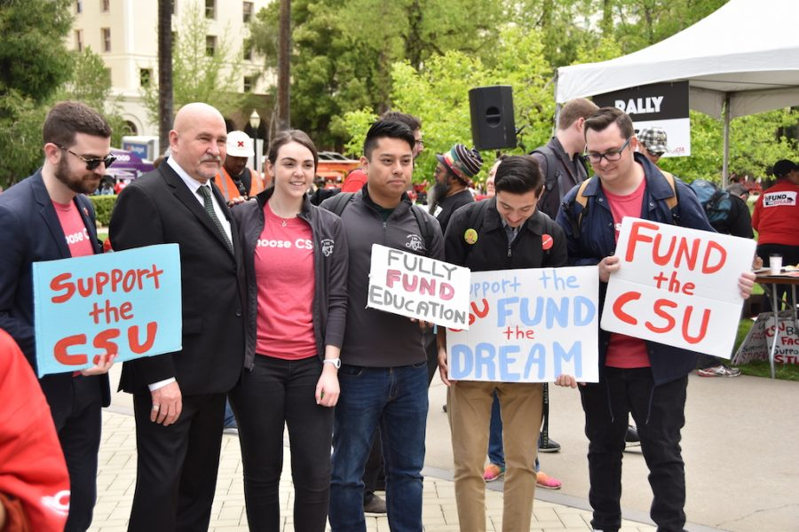 Sacramento+State+President+Robert+Nelsen+and+Associated+Students+Inc.+President+Mia+Kagianas+stand+with+protesters+at+the+Capitol.+The+CFA+and+the+SQE+held+a+protest+on+the+Capitol+lawn+on+Wednesday%2C+April+4+against+CSU+underfunding+and+an+incoming+tuition+hike.