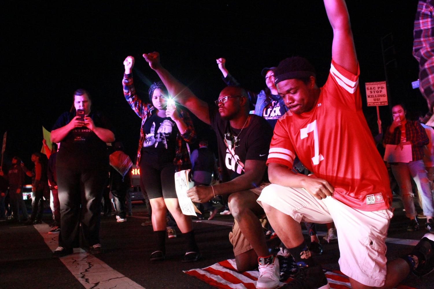 Protesters+occupy+Florin+Road+before+a+blockade+of+Sacramento+police+during+a+march+for+Stephon+Clark+on+Saturday%2C+March+31%2C+2018.+Activists+took+to+the+streets+of+southern+Sacramento+to+raise+awareness+to+the+recent+shooting+of+unarmed+black+man+Clark+in+his+grandmother%27s+backyard+by+Sacramento+officers.