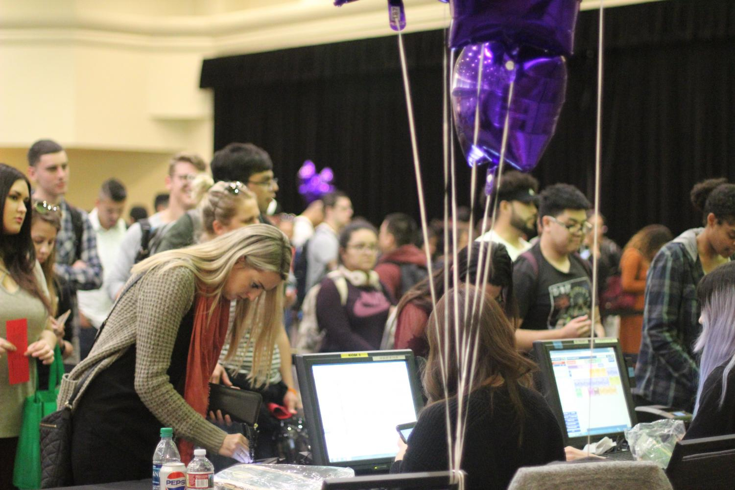 Graduating seniors stand in line to pay for their cap and gown at Grad Fest in the University Union Ballroom on March 28, 2018.