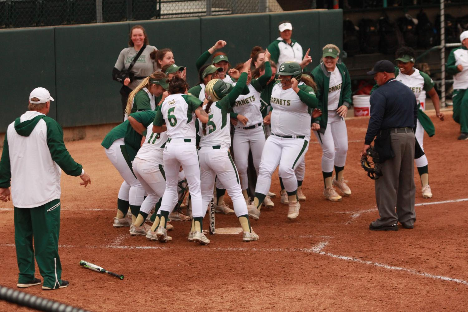 The Sacramento State softball team congratulates sophomore designated player Alexxiss Diaz, middle, after she hit a walk-off home run against Portland State at Shea Stadium on Thursday, April 5, 2018. The Hornets defeated the Vikings 1-0 in extra (8) innings.