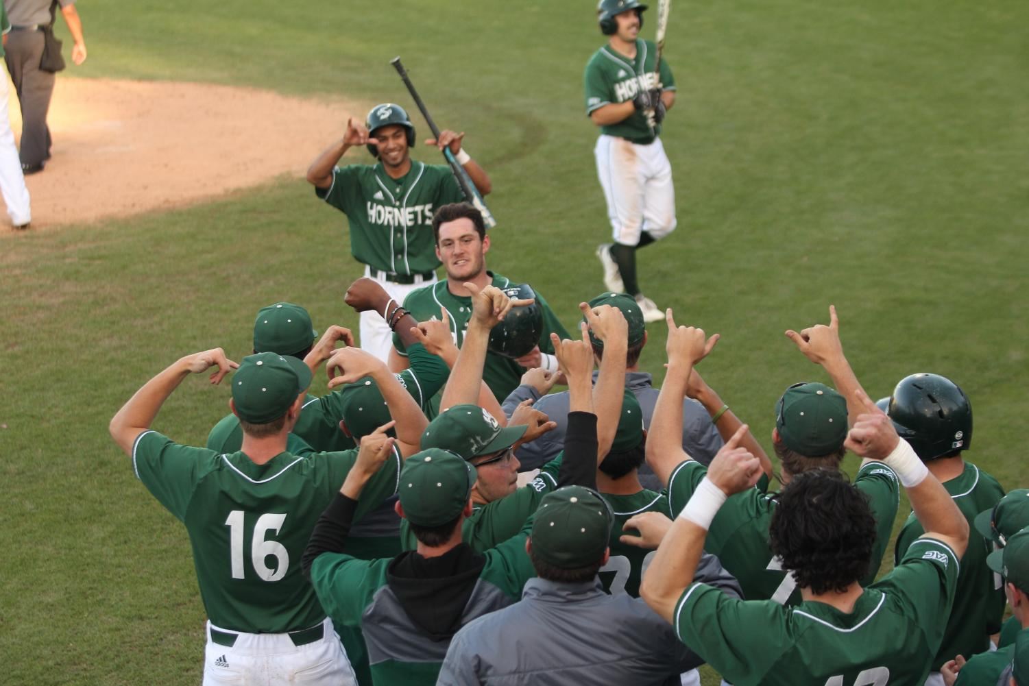 Sacramento State freshman second baseman and Hawaii native Keith Torres, middle, celebrates behind his teammates as they hold up the Shaka sign after he hit his first career home run against Chicago State at John Smith Field on Saturday, April 7, 2018. The Hornets defeated the Cougars 13-1.