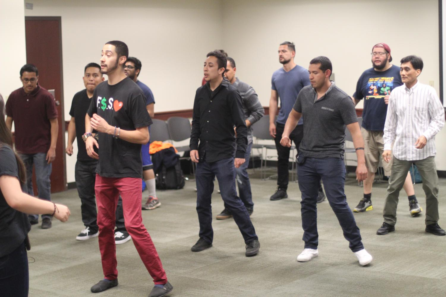 Instructor Jimmy Mendoza teaches some Bachata moves at Salsa Loca in the University Union.