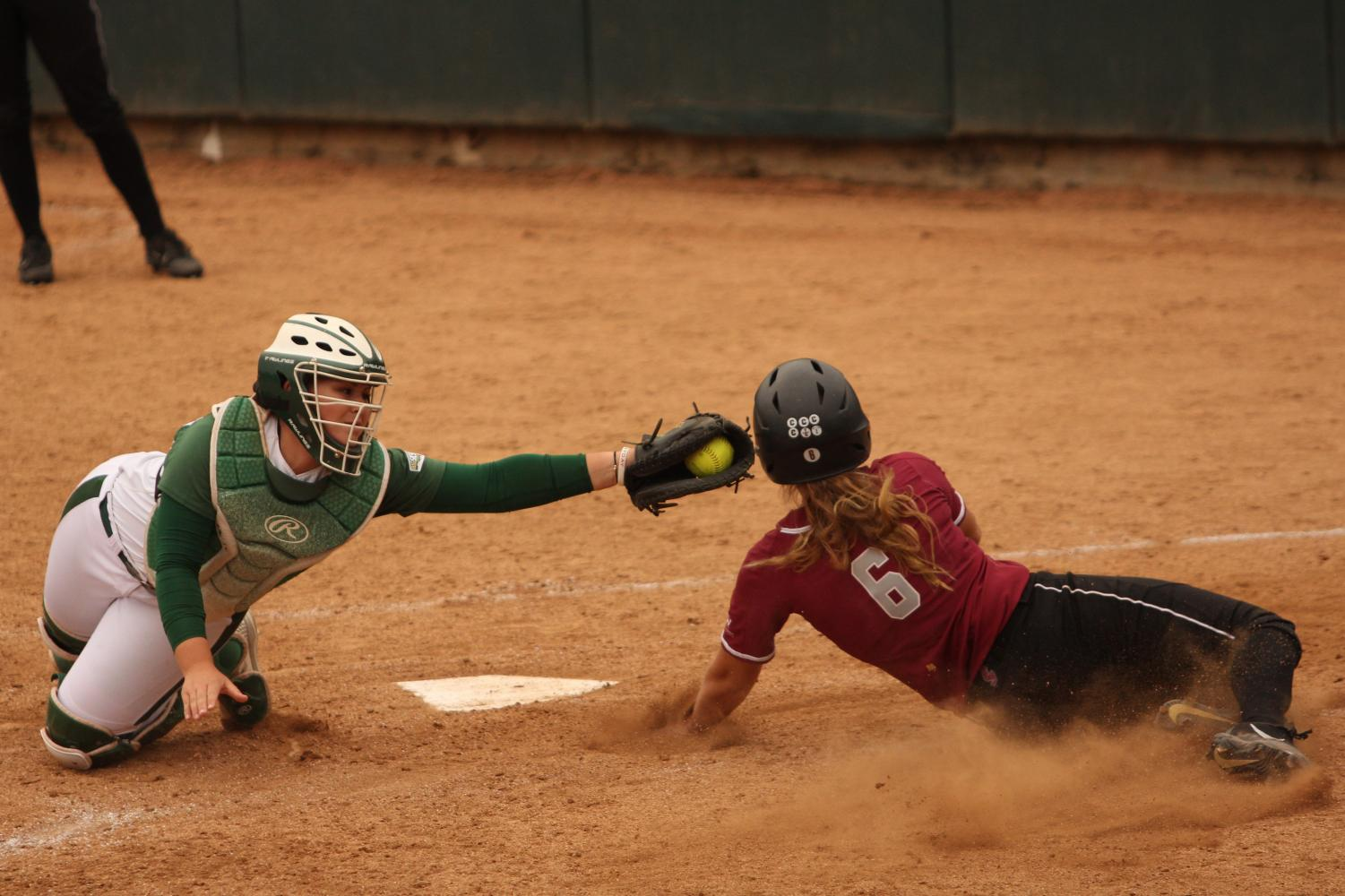 Sacramento State sophomore catcher Jessica Scott tags out Santa Clara University junior second baseman Kelsie Barnard at home plate at Shea Stadium on Wednesday, April 11, 2018. The Hornets defeated the Broncos 3-1.