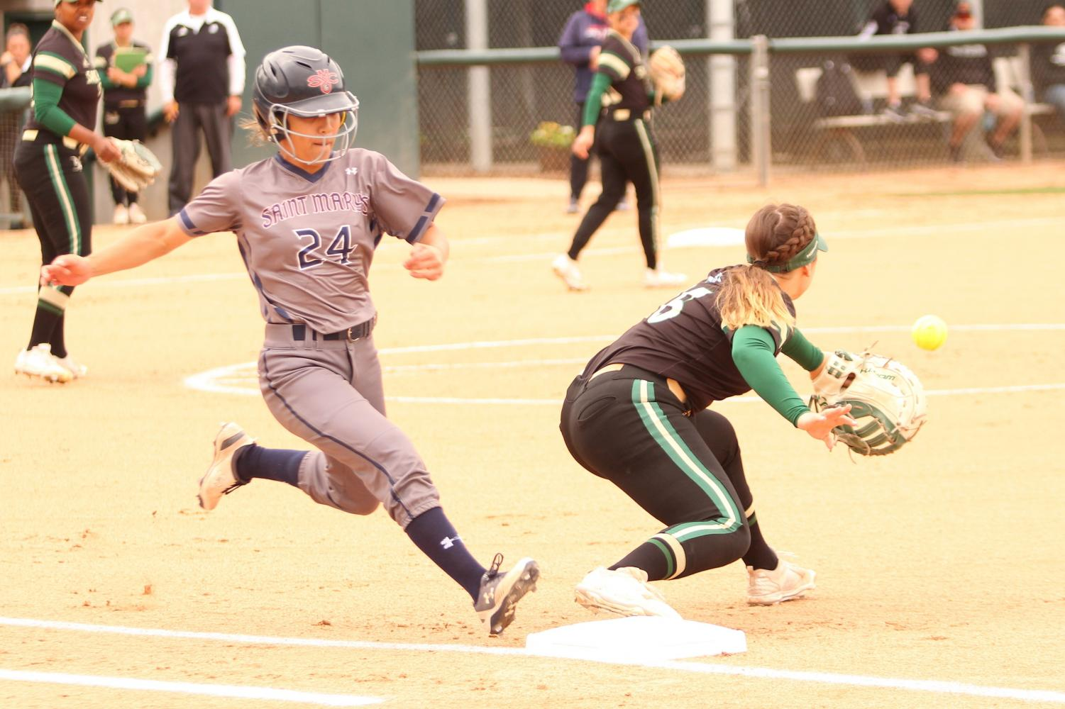 Sacramento State sophomore first baseman Mo Spieth stretches for the ball as Saint Mary's College freshman outfielder Kimiko Zapanta reaches safely at first base at Shea Stadium on Wednesday, April 18, 2018. The Hornets lost to the Gaels 1-0.