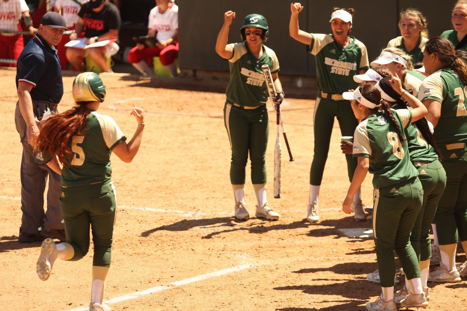 Sacramento State sophomore outfielder Suzy Brookshire and her teammates perform the University's signature