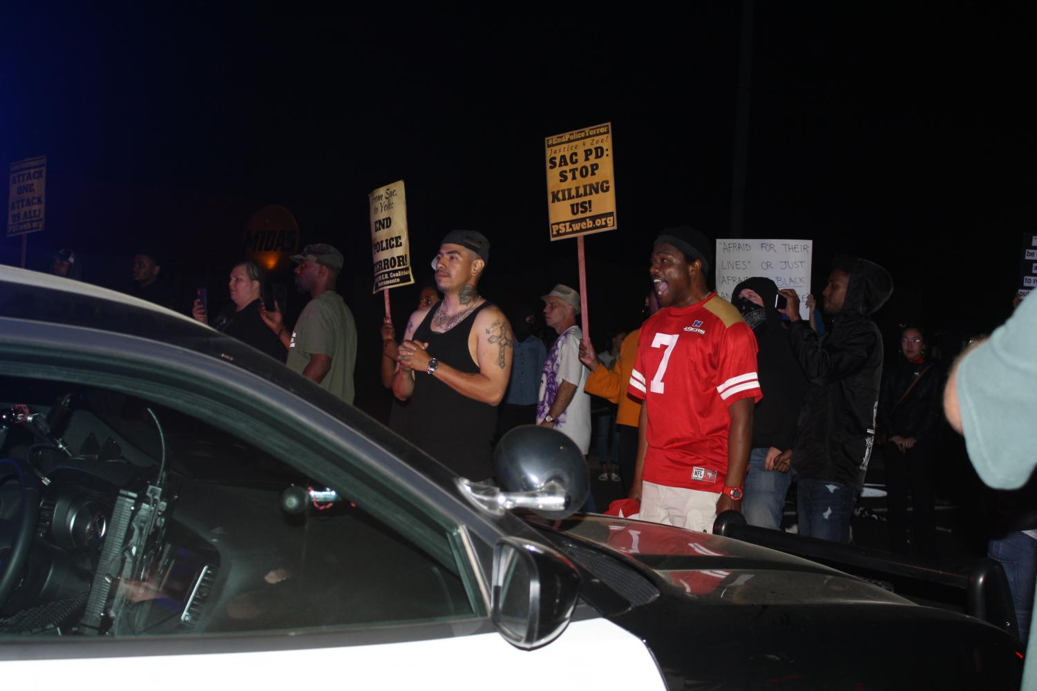 Protesters+moved+in+on+Sacramento+County+Sheriff%27s+Department+vehicles+after+bringing+traffic+to+a+near-complete+stop+on+the+night+of+Saturday%2C+March+31+2018.+The+department+said+the+protesters+were+%22yelling+while+pounding+on+the+vehicles%27+exterior.%22