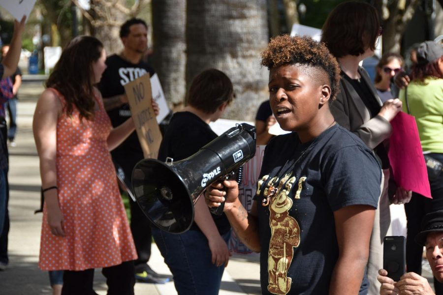 Lindsay Williams, a Black Lives Matter Sacramento protester, leads the crowd in chants with a megaphone. BLM held a protest at the DA's office on Tuesday, April 3 in response to the shooting of Stephon Clark, an unarmed black man.