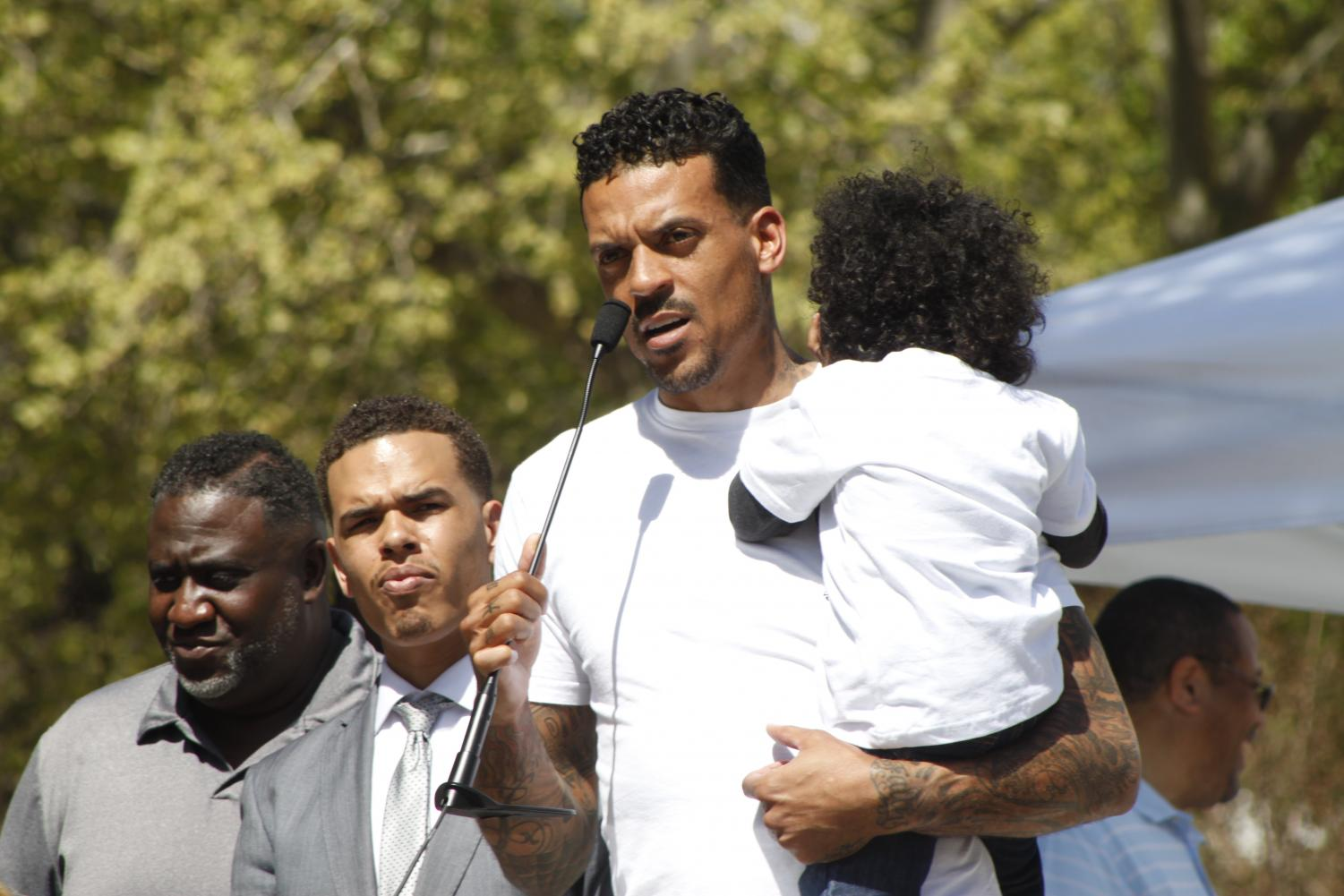 Former Sacramento Kings player Matt Barnes holds one of the children of Stephon Clark, who was recently shot and killed by police, during the March and Rally for Action on March 31, 2018. Barnes created the event to spread awareness of the shooting and preach change.
