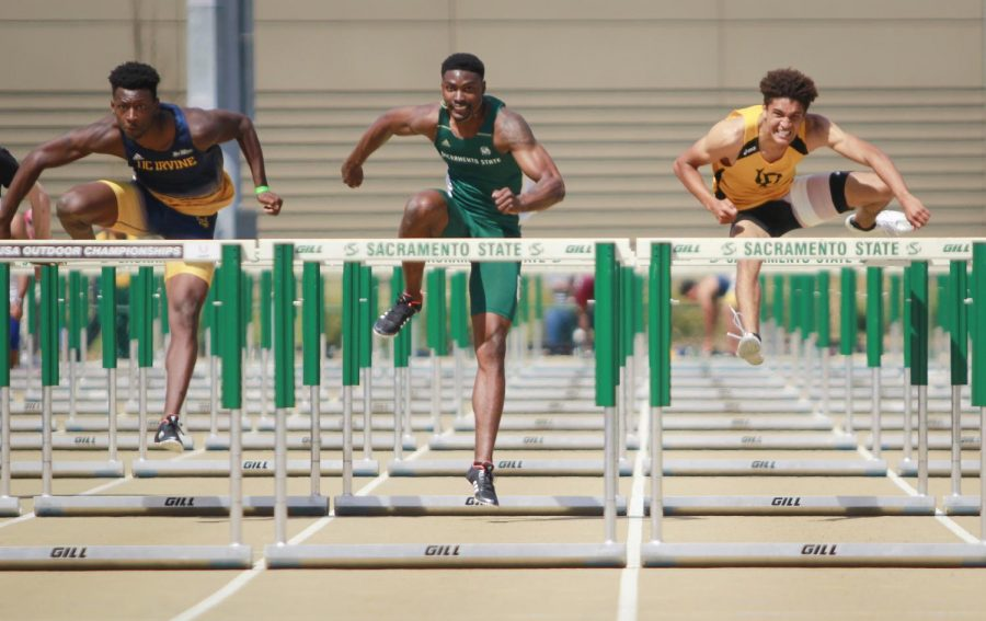 Sacramento State junior Andre Lindsey, center, runs against UC Irvine's Asa Allen, left, and Long Beach State's Raleigh Adams, right, in the men's 110 meter hurdles during the Mondo Team Challenge at Hornet Stadium on Saturday, March 31, 2018. Lindsey placed first in the race by .003 of a second.